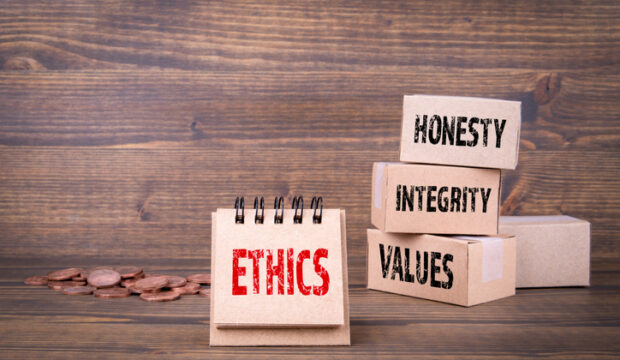 Ethics oncept. Honesty, integrity and values words. Paper boxes on wooden background